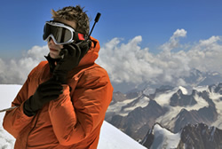Satellite Phone User in the Mountains
